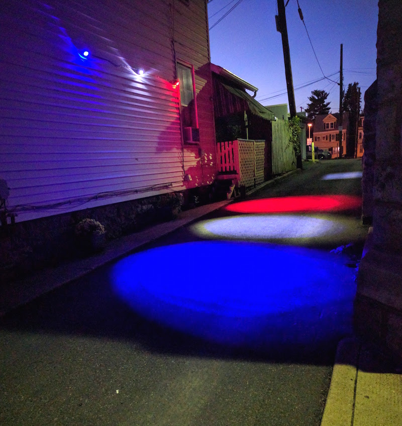 Customer uses 20W red, white, and blue LED spotlights to light up street